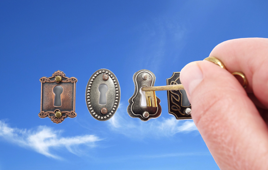 Vintage locks with hand, key and sky